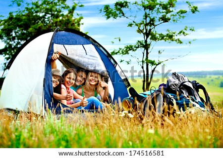 Group people with backpack in tent summer outdoor. - stock photo