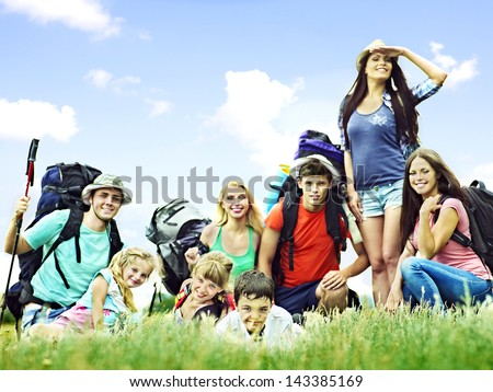 Group people with backpack  summer outdoor. Focus on the boy. - stock photo