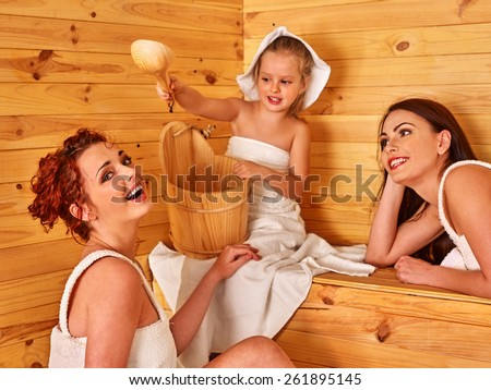 Group people with child in sauna. Healthy lifestyle. - stock photo