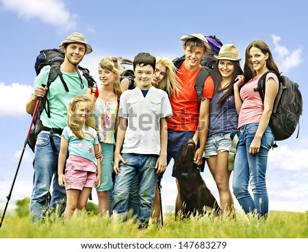 Group people with children  on travel. - stock photo