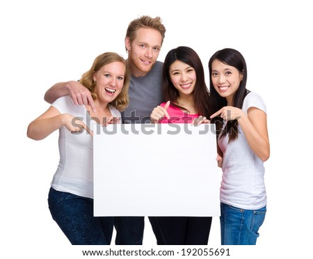 Group people with diverse ethnicity holding blank sign for your text