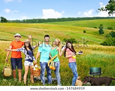 Group people with dog on picnic. Outdoor. - stock photo
