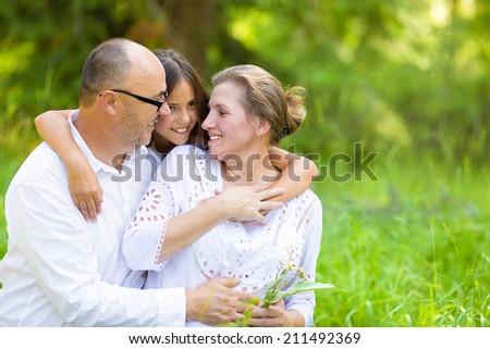 Group Portrait happy smiling family with one child outdoors nature on sunny summer day, park forest. Children parents, grandparents. Positive human emotion, facial expression, feeling, life perception - stock photo