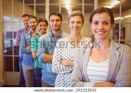 Group portrait of a smiling creative business team looking at the camera - stock photo
