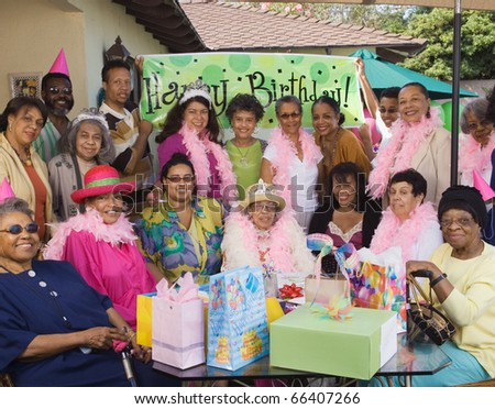 Group portrait of elderly woman's birthday party - stock photo