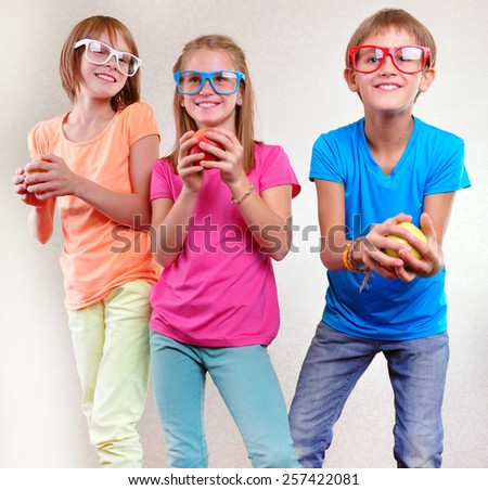 group portrait of funny kids with apples posing - stock photo