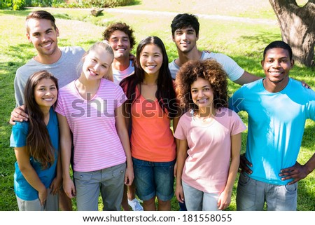 Group portrait of happy university students standing together on campus