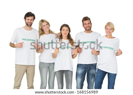 Group portrait of happy volunteers pointing to themselves over white background - stock photo