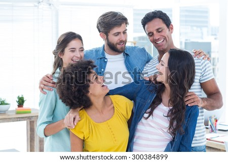 Group portrait of happy young colleagues in the office - stock photo