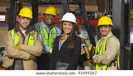 Group portrait of industry workers - stock photo