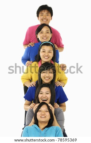 Group portrait of the young happy smiling family looking at camera