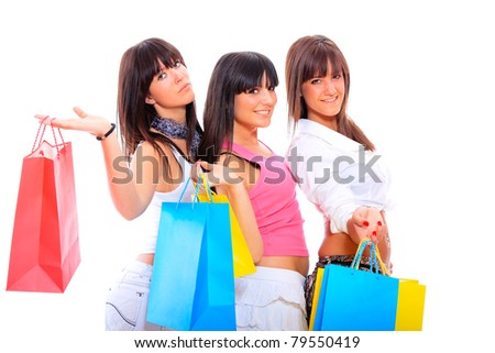 group portrait of three happy young adult girls with colored bags