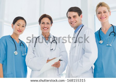 Group portrait of young doctors standing together at the hospital - stock photo