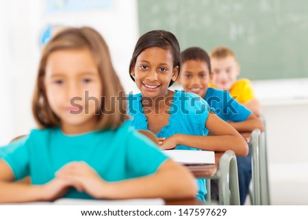group primary school students in classroom - stock photo