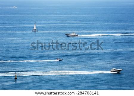 Group sailing of luxury yachts in Mediterranean Sea near French Riviera, Monaco - stock photo