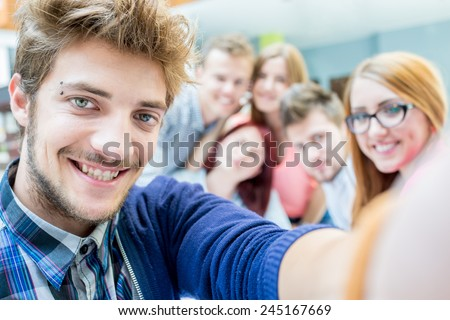 Group selfie of business friends discussing brainstorming and ideas at meeting inside beautiful modern building place - stock photo