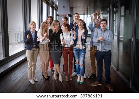 Group shot of business people in modern office hall. Post processed with vintage film filter. - stock photo