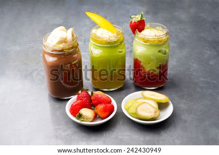 Group shot of fruit smoothies - stock photo