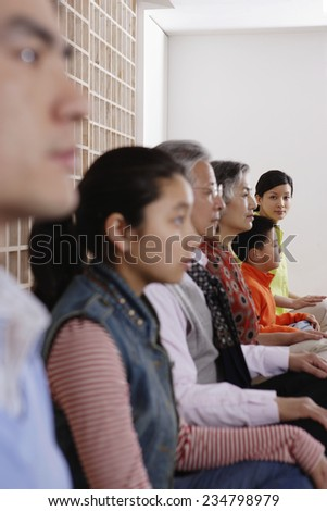 Group Sitting in Lotus Position