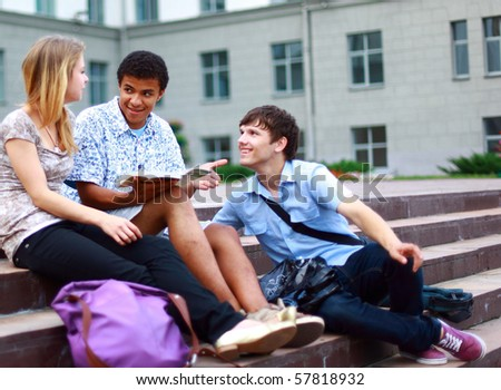 Group students outside sitting on steps