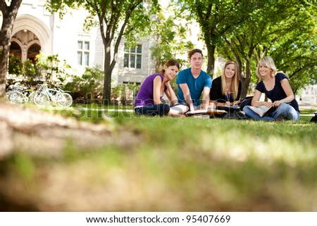 Group study session with four students - stock photo