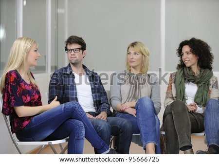 group therapy: diverse people talking and giving support - stock photo
