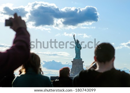 Group Tourists before Statue of Liberty Ferry, NYC. - stock photo