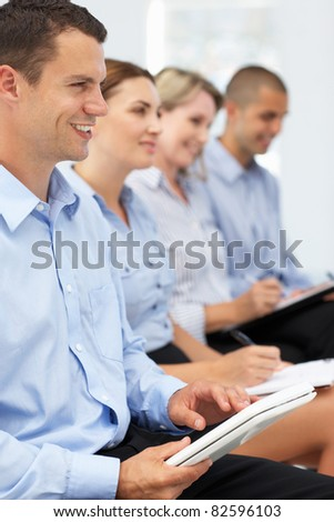 Group watching business presentation - stock photo