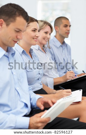 Group watching business presentation
