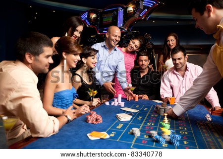 group with winning player getting his chips - stock photo