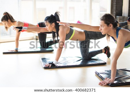 Group women stretching training exercising in gym practicing yoga pilates. - stock photo