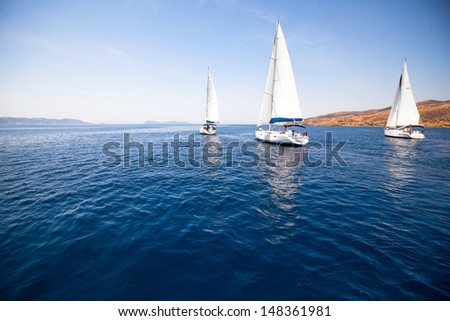 Group yacht sailing  - stock photo