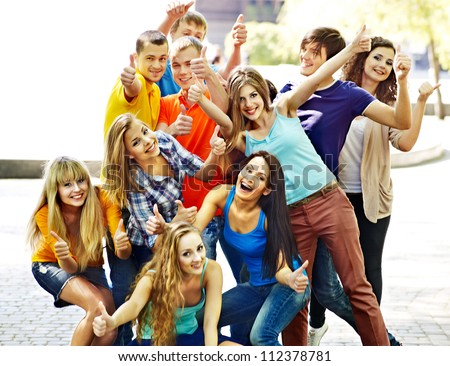 Group young happy people in summer outdoor. - stock photo