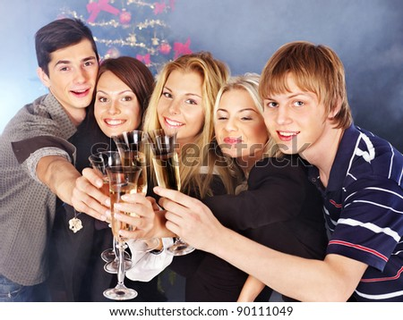 Group young people drinking champagne at nightclub. Christmas. - stock photo