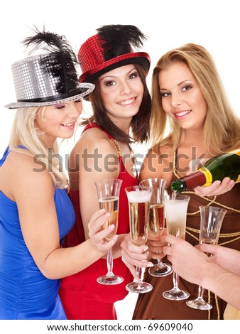 Group young people in party hat drinking champagne. Isolated. - stock photo