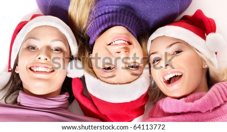 Group young people in santa hat lying  head to  head. - stock photo