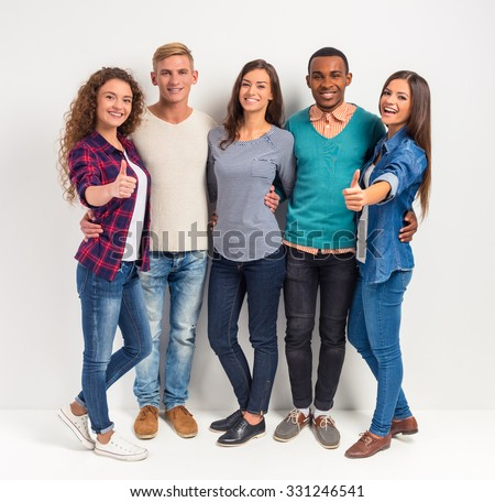 Group young people, students on a white background. Studio shooting