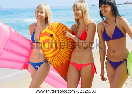 Group young woman model activity on the beach - stock photo