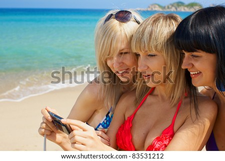 Group young woman model activity on the beach with photo - stock photo