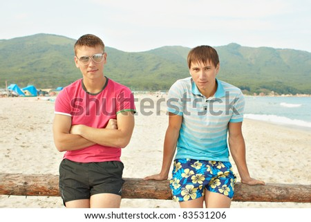 Group young womans and boys model having fun on the beach - stock photo