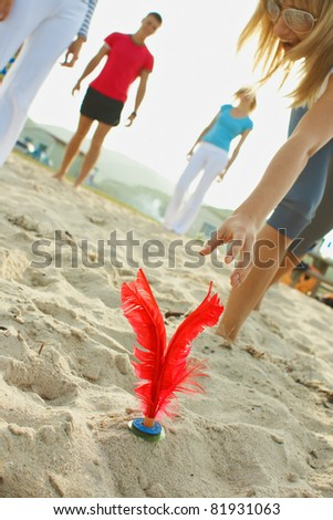 Group young womans and boys sport activity on the beach - stock photo