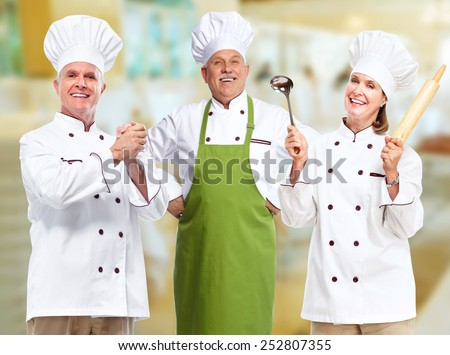 Groupe of professional chef in modern restaurant. - stock photo