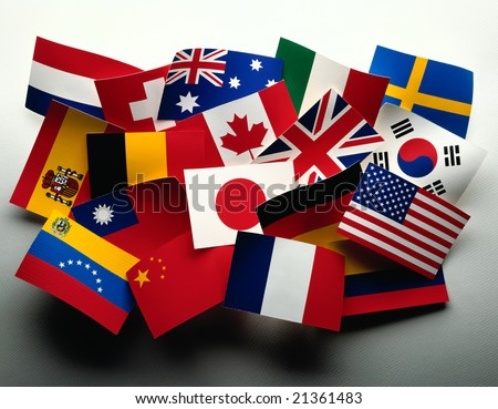 Grouping of various flags of the world on white - stock photo