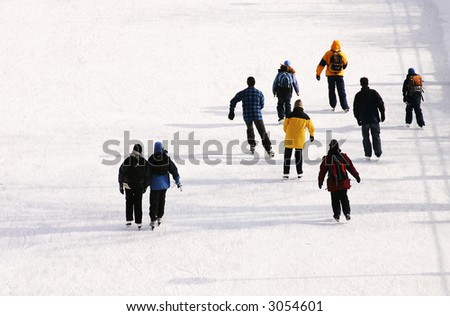Groups ice skating on canal