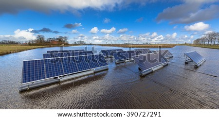 Groups of Floating solar panels on unused water bodies can represent a serious alternative to ground mounted solar systems - stock photo