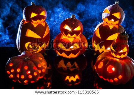 Groups of strange pumpkins for Halloween - stock photo