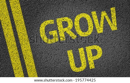 Grow Up written on the road - stock photo