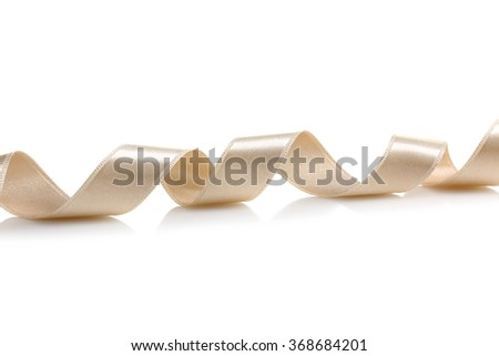 growing festive gold ribbon isolated on a white background.Design element - stock photo