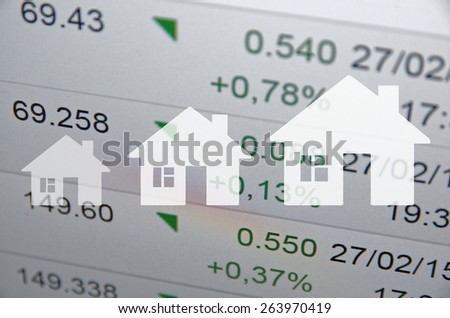 Growing Housing Market. House icon on financial background. - stock photo
