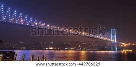 Growing Istanbul bridge with city light. - stock photo